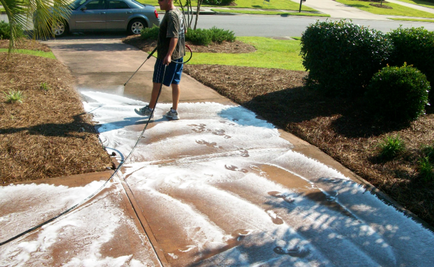 applying cleaning solution before power spraying a walkway